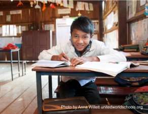 Boy working in class, UWS Ol Tuch School, Cambodia (photo by Anna Willett)