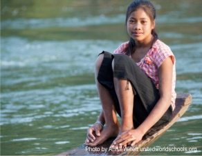 Girl on boat by the river, Som Village, Cambodia (Photo by Anna Willett) unitedworldschools org